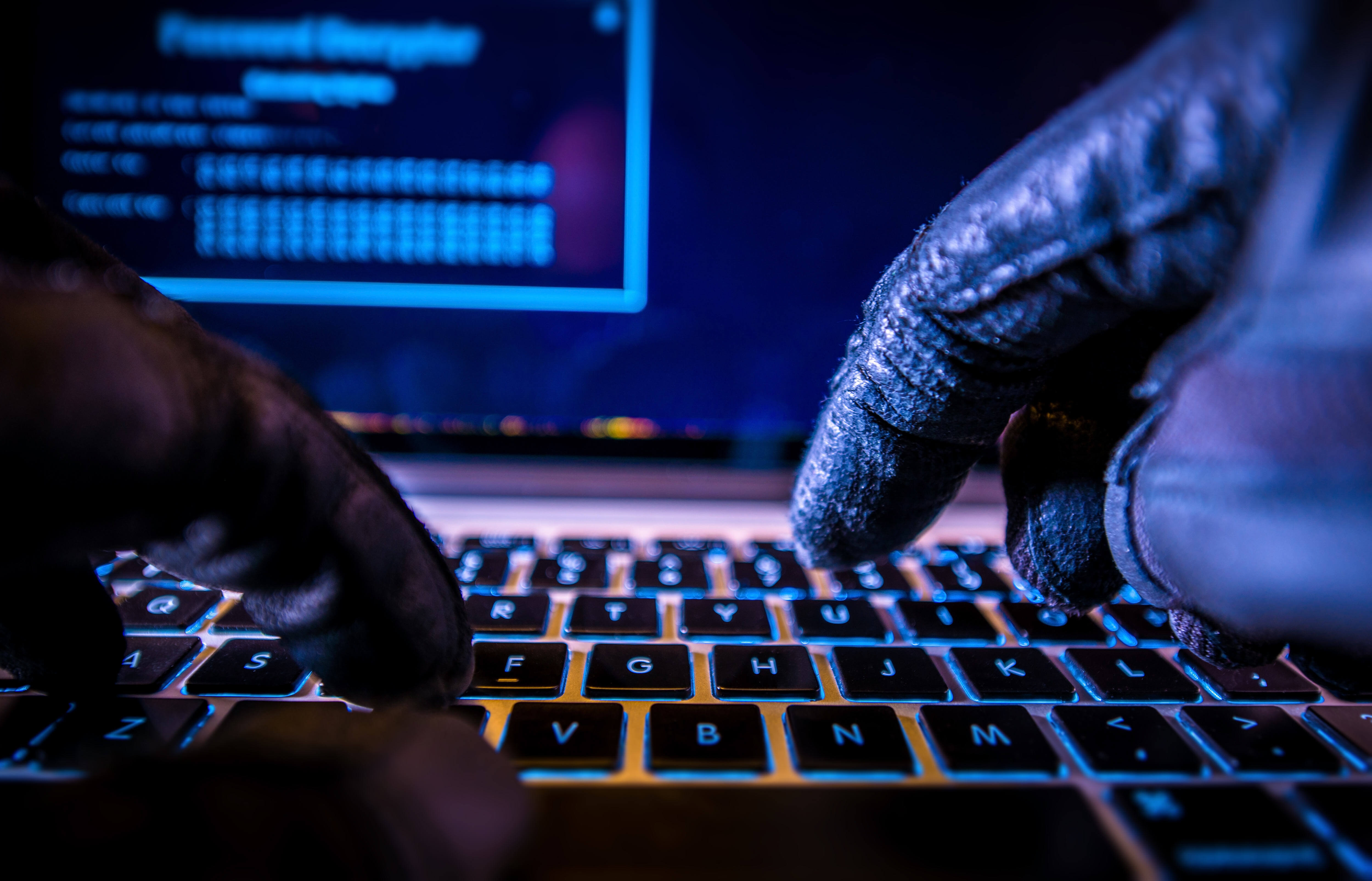 Payments System Hacking. Online Credit Cards Payment Security Concept. Hacker in Black Gloves Hacking the System, Cyber Attack, Data Breach, Hacker, Data Management, Data Center, Cloud Storage, Tallahassee, Valdosta, Tifton, Albany, Thomasville, Bainbridge, Moultrie, Jacksonville, Dothan, Atlanta