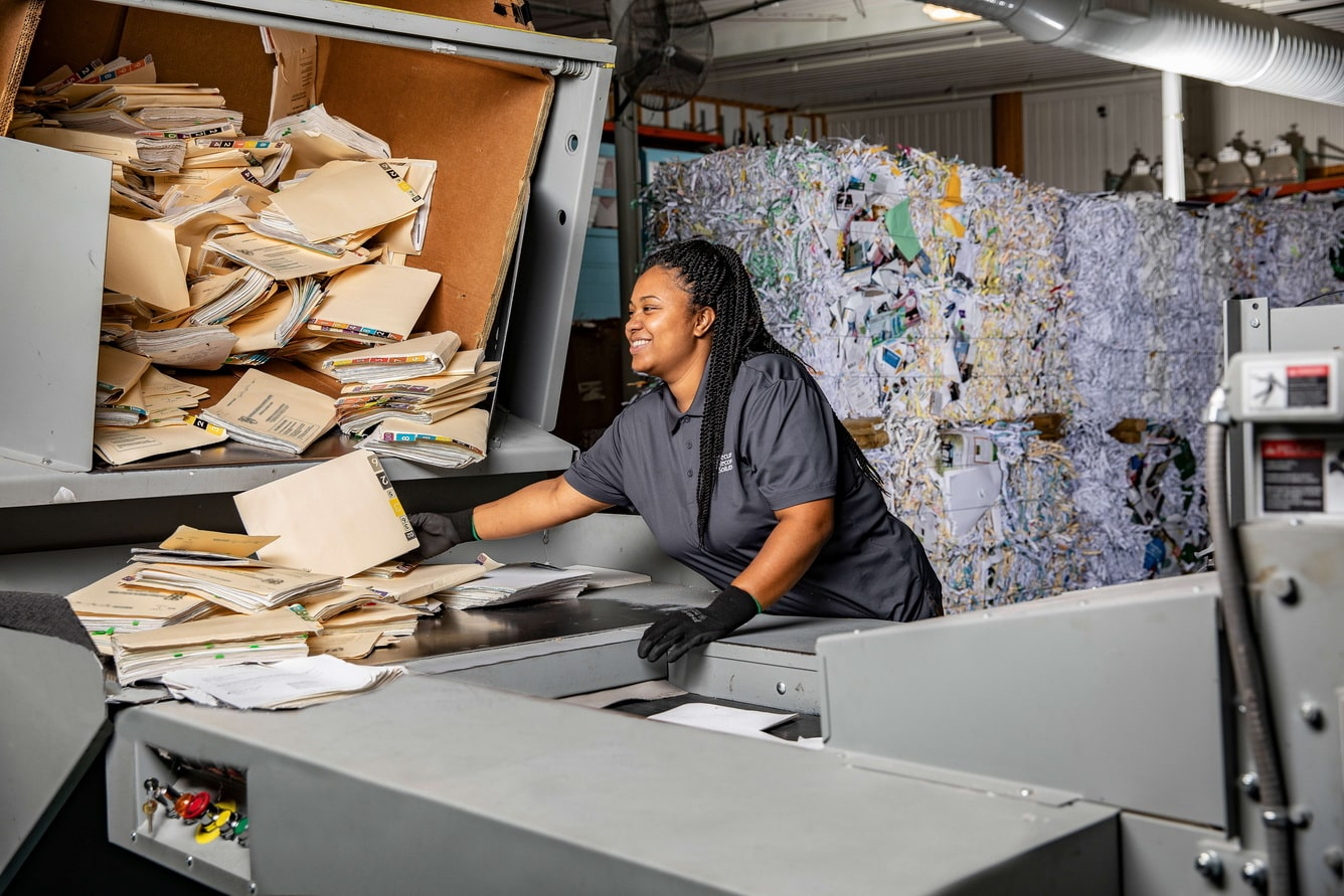 Vanessa with Secure Records Solutions shredding documents at our secure shred facility
